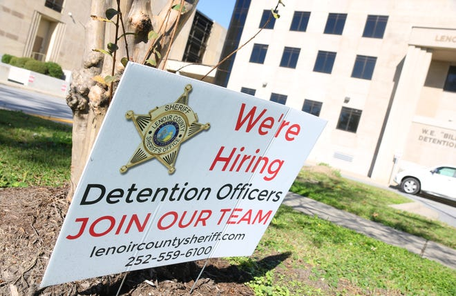 A sign outside the Lenoir County Courthouse shows the Sheriff's Office is looking to hire more detention officers to the jail.