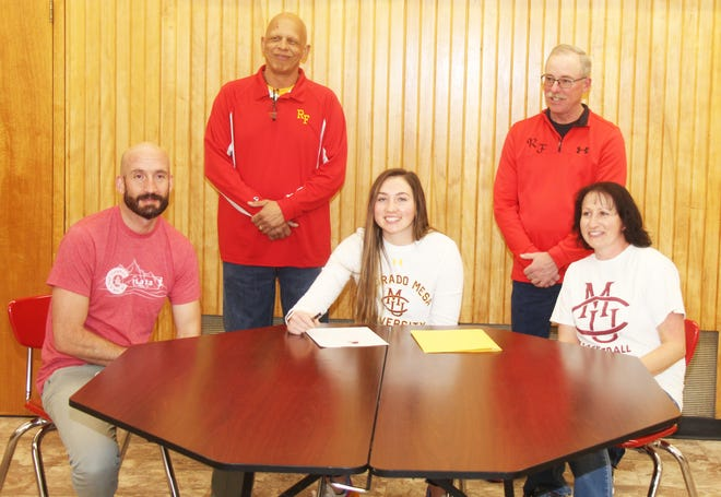 Rocky Ford High School's Abigail Snyder (front row center) signed a national letter of intent to play women's basketball at Colorado Mesa University. Also pictured (back row from left) Rocky Ford head coach Mark Henson and assistant coach Cody Ridennoure. Front row (from left) Kermit Snyder (Abigail's father), Snyder and Rhonda Snyder (Abigail's mother).