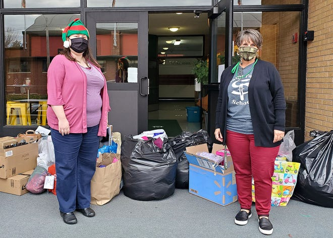 On November 20, 2020, St. Paul Principal Laura Cody (right) presented WIRC-CAA Public Relations Manager Jamie Roth (left) with Project Santa donations collected by staff and students.  The donation included toys, clothing, hand-knit hats and scarves, winter coats and a monetary donation.