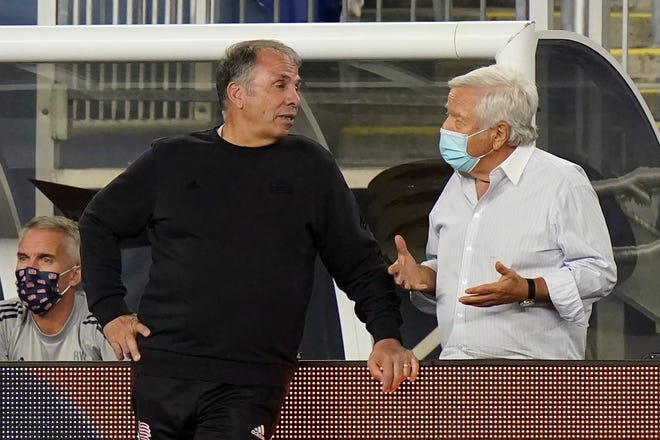 New England Revolution head coach Bruce Arena (left) speaks with New England Patriots football team owner Robert Kraft during the second half of an MLS soccer match against the Montreal Impact on Sept. 23, 2020, in Foxborough. Arena saw his team fall to the Columbus Crew in the Eastern Conference final on Sunday.