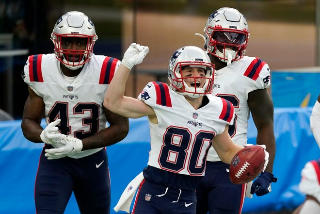 New England Patriots wide receiver Gunner Olszewski (front) celebrates after returning a punt for a touchdown during the first half of an NFL football game against the Los Angeles Chargers Sunday in Inglewood, Calif.