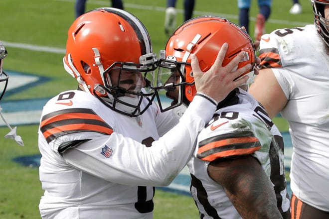 Browns quarterback Baker Mayfield (6) and receiver Jarvis Landry (80) celebrate a Sunday touchdown against the Titans.