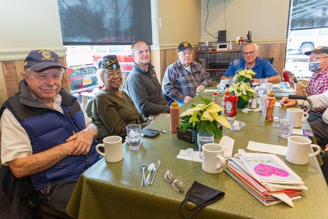 Veterans Bob Haggett, Leonore Dey, Brian Shelton, Troy Shelton, Dan Williams and Al Johnson, left to right, swap stories and enjoy breakfast at Brady J's in East Bloomfield.