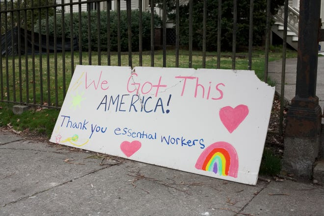 An encouraging handmade sign on display on Kay Street in April.