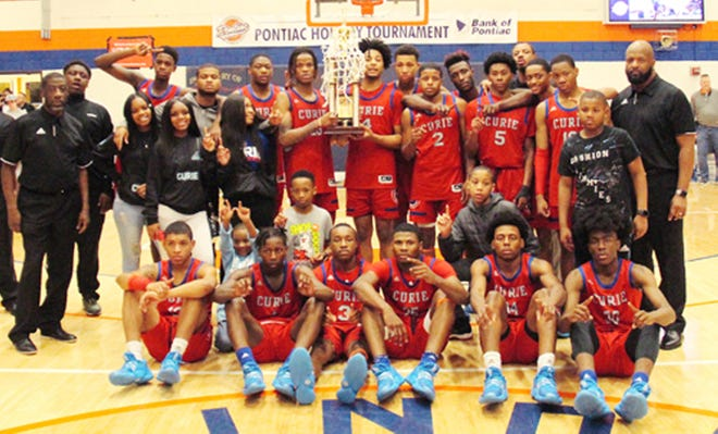 Two-time defending Pontiac Holiday Tournament champion Chicago (Curie), shown here after winning in 2019, will have to wait another year before trying to three-peat.
