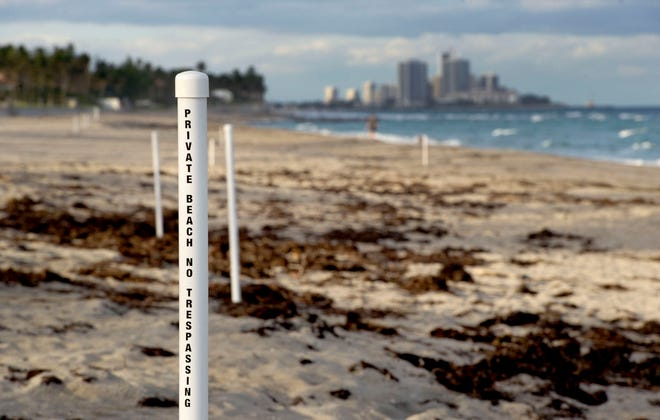 As of December 3, 2020, plastic posts at the erosion control line are in place to advise where beachgoers can be cited for trespassing.