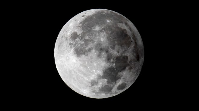 The full moon during a penumbral lunar eclipse over West Palm Beach, Nov. 30.