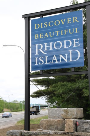 A sign welcomes travelers to Rhode Island.