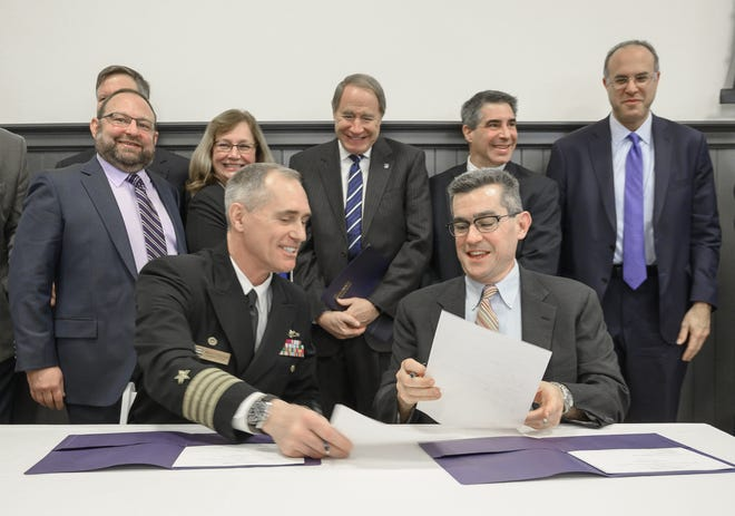 Published Caption:  Capt. Michael R. Coughlin, commanding officer at the Naval Undersea Warfare Center and Christian Cowan, director of Polaris MEP, complete the ceremonial signing of the Partnership Intermediary Agreement for the 401 Tech Bridge Advanced Materials Center, in December 2019 at Innovate Newport. [DAVE HANSEN/FILE PHOTO] Original Caption:  Capt. Michael R. Coughlin, Commanding Officer, Naval Undersea Warfare Center and Christian Cowan, Director, Polaris MEP, complete the ceremonial signing of the Partnership Intermediary Agreement for the 401 Tech Bridge Advanced Materials Center, Monday at Innovate Newport.