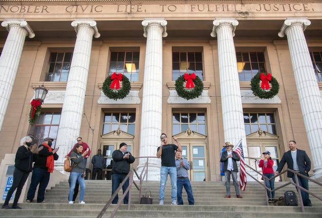 "Business owners stage a rally earlier this month on the steps of City Hall in downtown Stockton calling for local government to declare Stockton a ""sanctuary city"" for businesses."