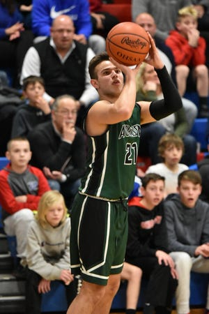 Gabe Elsawy shoots a 3-pointer against Revere.