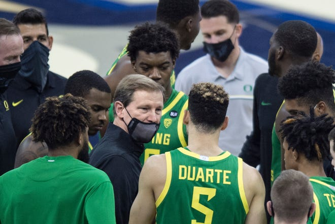 Oregon coach Dana Altman, center, talks to his players prior the start of the Ducks'  game against Seton Hall on Friday. (AP Photo/Kayla Wolf)