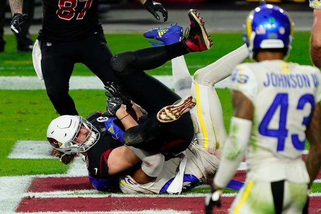 Arizona Cardinals tight end Dan Arnold falls in the end zone for one of his two touchdown catches against the Los Angeles Rams on Sunday, Dec. 6, 2020, in Glendale, Ariz. The Rams still won 38-28.