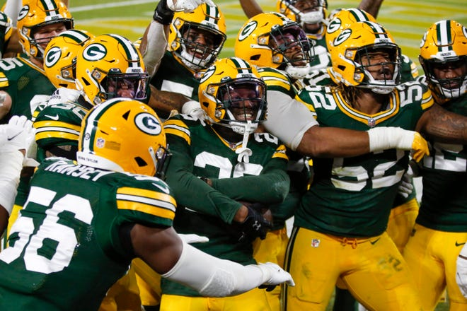 Green Bay Packers' Darnell Savage celebrates with teammates after his interception during the second half of an NFL football game against the Philadelphia Eagles Sunday, Dec. 6, 2020, in Green Bay, Wis. The Packers won 30-16. (AP Photo/Matt Ludtke)