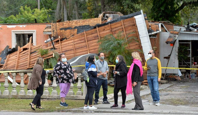 Members of the Lopez family gather in front of their home on Eighth Street West in Bradenton before a press conference Monday afternoon.