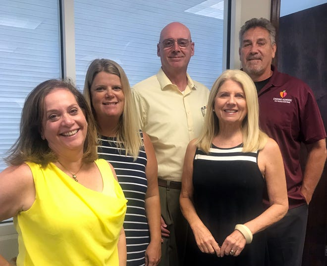 Members of All Faiths Food Bank's leadership team include, from left, Denise Cotler, chief development officer; Colleen Reinert, strategic program officer; Mike Ziebell, chief accounting officer; Sandra Frank, CEO; and John Livingston, COO.