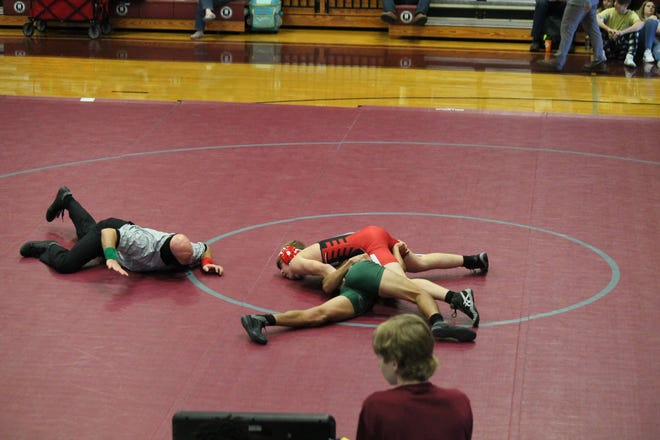 Bryan County's Austin Edwards on his way to getting a pin during the Turkey Duals at South Effingham.