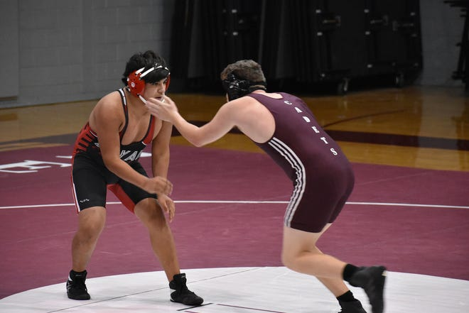 Bryan County's Raul Parrish, left, squares off against a Benedictine wrestler on Saturday at Benedictine.