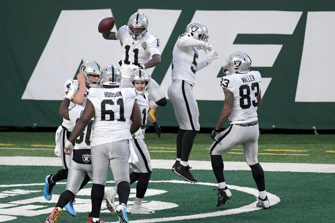 Las Vegas Raiders' Henry Ruggs III, top left, celebrates his touchdown Sunday, Dec. 6, in East Rutherford, N.J.