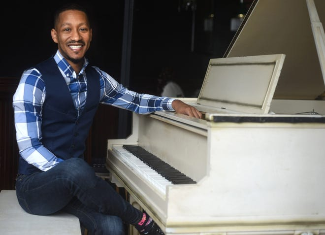 Wilmington musician Brian Whitted sits at the piano at Tails Piano Bar in Wilmington, N.C., Monday, December 7, 2020.   [MATT BORN/STARNEWS]