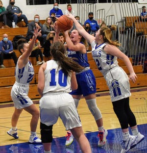 Collins-Maxwell's Kenzi Wierson goes up for a shot as she's swarmed by Colo-NESCO's Izabell Voelker (left), McKenzie Niemeyer (10) and Jenna Banks during the first half of the Spartans' 59-31 victory over the Royals Dec. 1 in Colo. Wierson had 14 points in the win.