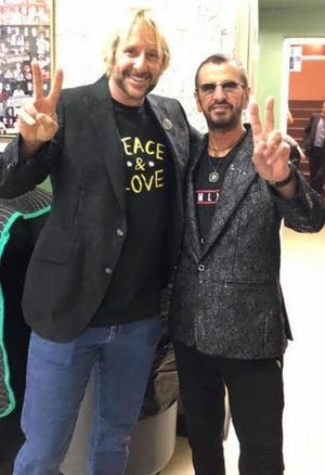 """Dan Hartwell, left, seen here with Beatle drummer Ringo Starr, will sign his new book """"Saint John Lennon"""" Saturday at That's Entertainment on Park Avenue in Worcester."""