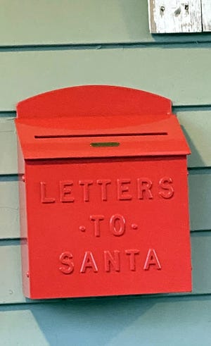 A mailbox outside the Lafferty's Lancaster home collects letters to Santa, so the family can help St. Nick answer children's letters.