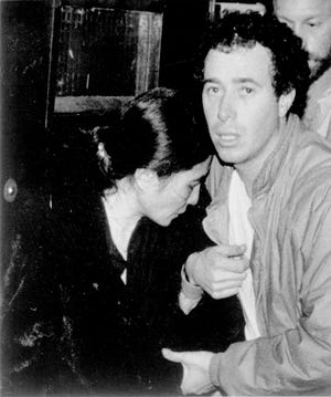 Record producer David Geffen comforts Yoko Ono as they leave Roosevelt Hospital in New York, Dec. 9, 1980, after the shooting and death of Ono's husband John Lennon. Lennon was shot and killed Dec. 8 as he returned to his apartment after returning from the recording studio.