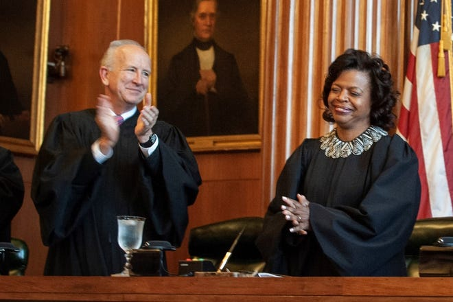 Associate Justice Paul Newby applauds for new Chief Justice Cheri Beasley of the N.C. Supreme Court during Beasley's investiture ceremony in Raleigh on Thursday, March 7, 2019.