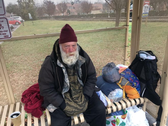 James Pitts has been sleeping at a bus stop across from Huske Hardware House in downtown Fayetteville. For various reasons, he will not try to take advantage of a city offer that puts homeless people in hotel rooms on white flag nights, where temperatures dip below 32 degrees. But Pitts said the hotel rooms sound like a good idea. The Salvation Army shelter on Alexander Street has suspended white flag services for at least another week because of a COVID-19 outbreak among the city's homeless.