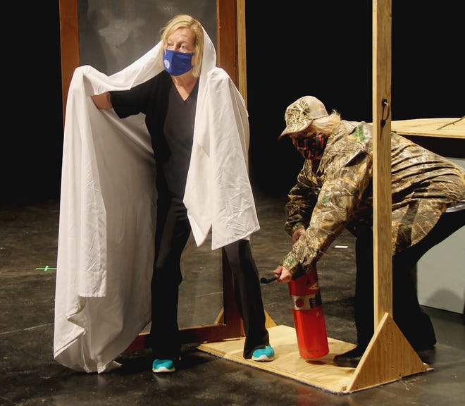 """Drew Baker and Tina Turley rehearse for Theatre Tuscaloosa's world premiere of """"Lights Out in Cootah County: A Country (COVID) Christmas Carol,"""" streaming on their YouTube channel Dec. 14-18. [Photo by Kiera Gillock]"""