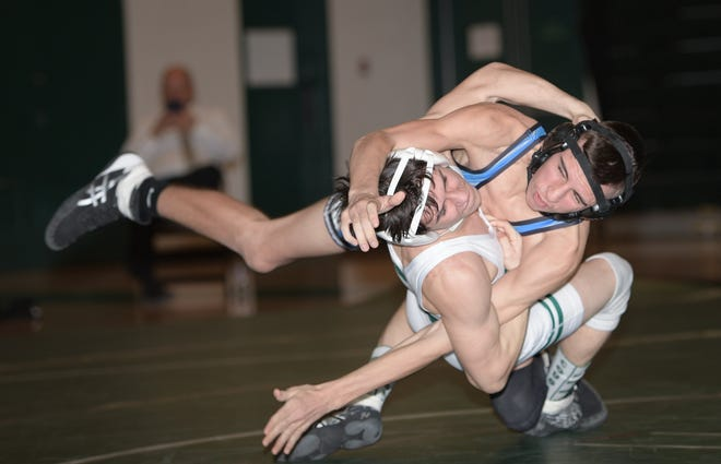 Tyler Jude (front) is among the top returnees for the Westland wrestling team and third-year coach Brent Allerding, who has high expectations despite having a small roster.