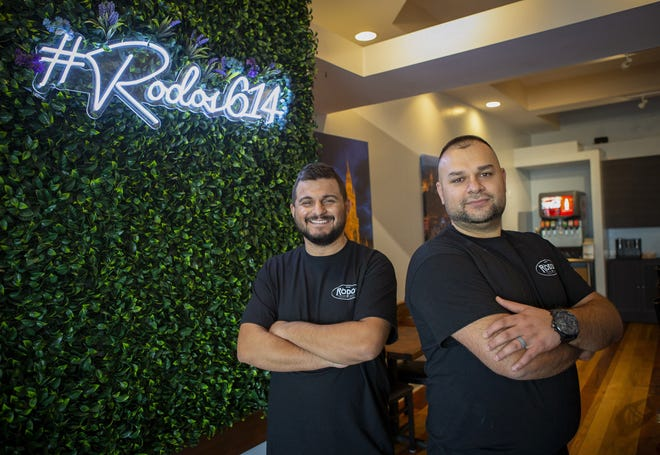 Klaudio Pali (left) and Erion Permeti have opened Rodos European Grill at 3369 Indianola Ave. in Clintonville. They are pictured at their restaurant Dec. 2.