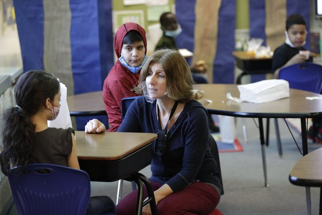 Teacher Sarah Wright poses the question of the day to Hialeaj Katara Perez Arno during a Newcomer class at McKinley Elementary School in Appleton.
