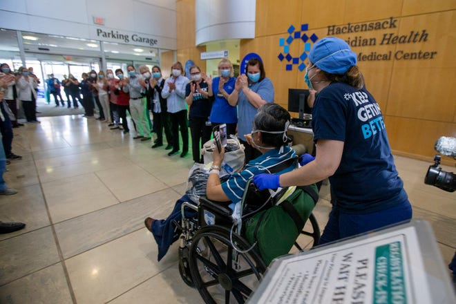 Ocean Medical Center holds a Hope Huddle as the 250th COVID-19 patient is discharged at Ocean Medical Center in Brick, NJ Thursday, April 30, 2020.