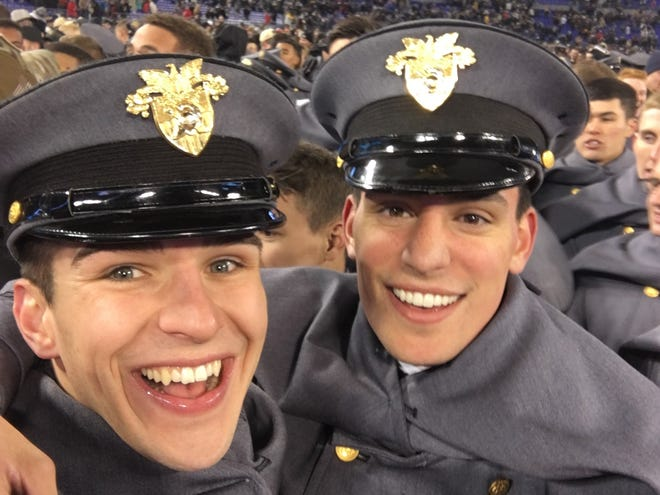 In this 2017 photo, Wyatt Frasier and Zachery Page meet at midfield following the Army-Navy college football game game at Lincoln Financial Stadium in Philadelphia, Pa. Page, an Olivet native, and Frasier have launched the nonprofit American Legacy Project.