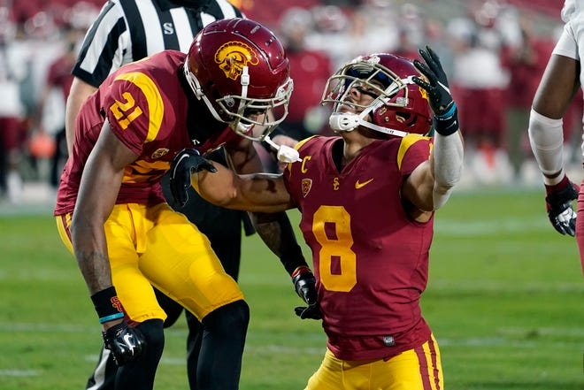 Southern California wide receiver Amon-Ra St. Brown, right, celebrates a touchdown catch with wide receiver Tyler Vaughns during the first half of an NCAA college football game against Washington State in Los Angeles, Sunday, Dec. 6, 2020.