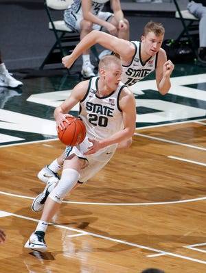 Michigan State's Joey Hauser, left, was scheduled to play against his older brother Sam, who is a senior forward on Virginia.