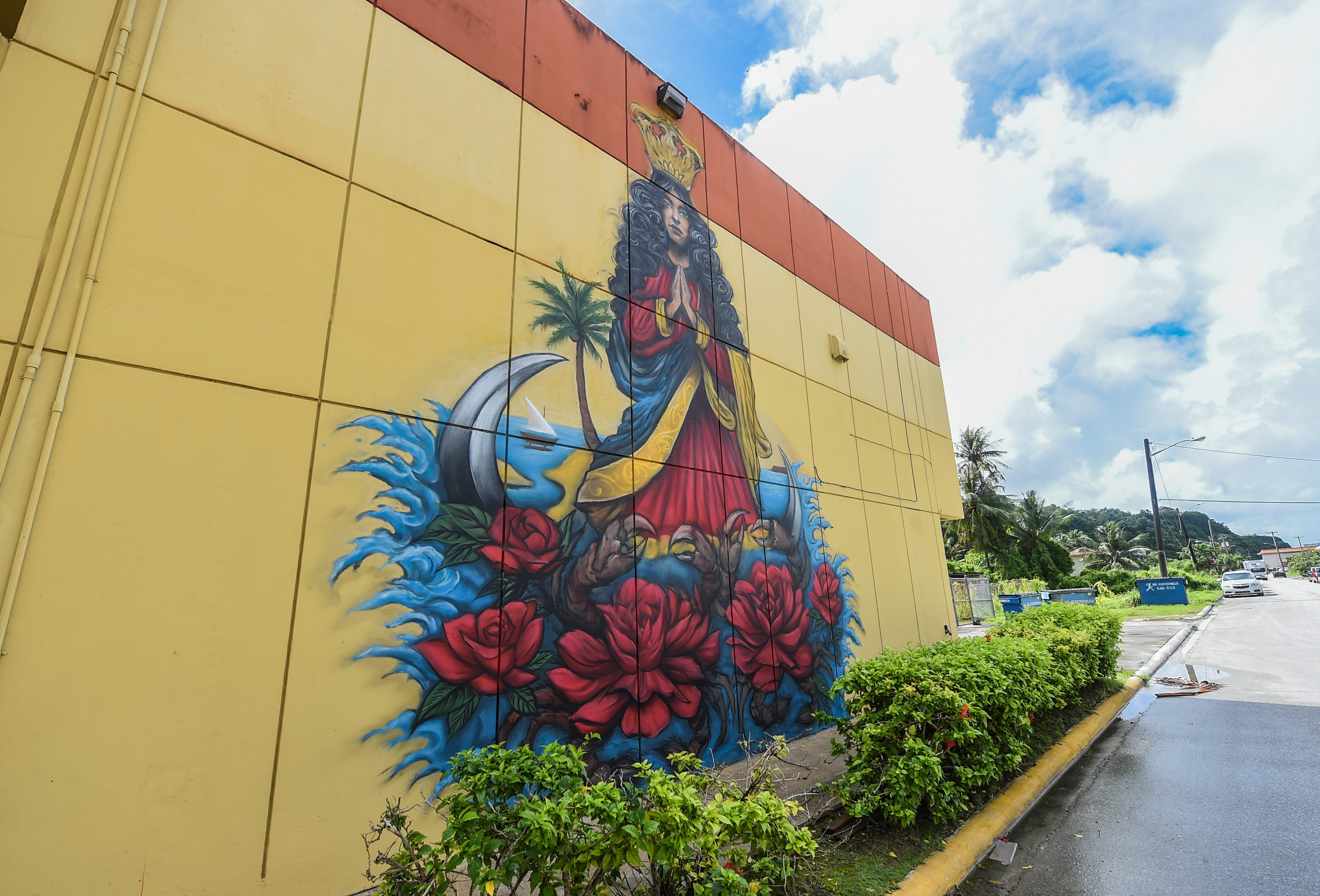 A mural of Santa Marian Kamalen has been completed by artist Kenny Malone in Hagåtña, Dec. 7, 2020. The mural, which is located on the side of Ada Plaza Center's Bldg. B, was commissioned by Crowns CEO, Randy Alcantara.