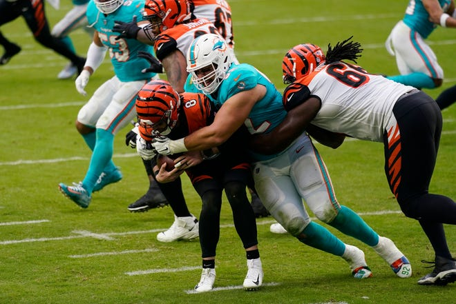 Cincinnati Bengals quarterback Brandon Allen is sacked by Miami Dolphins defensive end Zach Sieler on Sunday, Dec. 6, 2020.