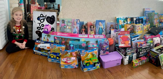 London Ratliff, 9, of Marion, is collecting toys for children in need this holiday season. As of last week, she had collected 160 toys. The items will then be sent to Christmas Clearinghouse.