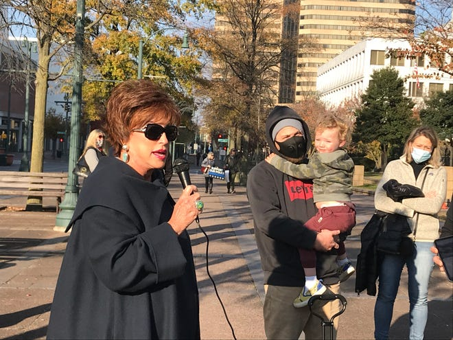 Jane Pierotti speaks at a rally of people opposing the closure of a Shelby County Commission meeting to the public due to the rise in COVID-19 cases Monday, Dec. 7, 2020.