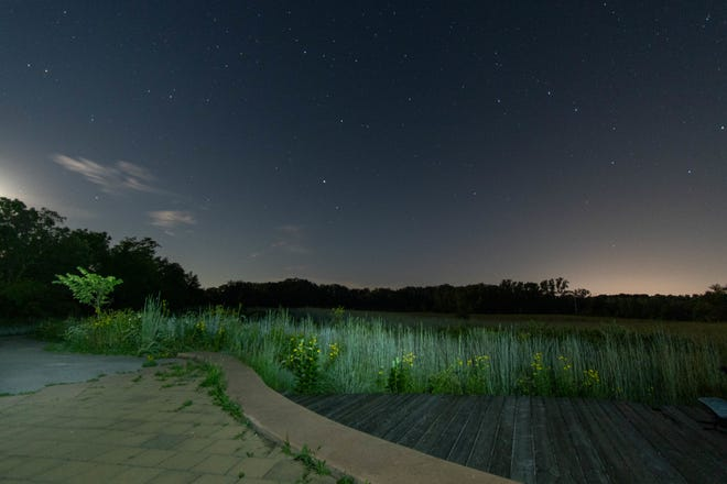An early evening sky at Red-tail Nature Preserve shows light pollution from Muncie on the horizon.