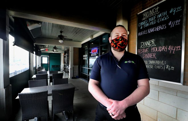 Josh Bilsky, the manger of Metro Diner in Murfreesboro stands on his heated patio, Monday, Dec. 7, 2020, that is open for dinning.