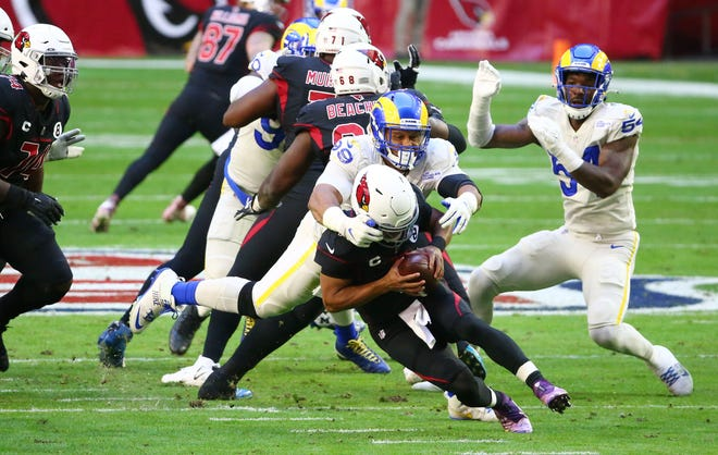 Los Angeles Rams defensive tackle Aaron Donald, shown sacking Arizona Cardinals quarterback Kyler Murray  during a game earlier this month, will be a big issue for the New England Patriots offensive line on Thursday night.