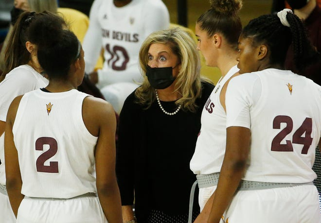 ASU's head coach Charli Turner Thorne talks with her team during the first half against UCLA at Desert Financial Arena in Tempe, Ariz. on Dec. 6, 2020.
