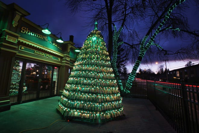 Shamrock Jack's Irish Pub has created a 15-foot high Christmas tree made from empty Jameson Irish Whiskey bottles, seen Monday, Dec. 7, 2020 outside the pub on Culver Rd in Irondequoit.