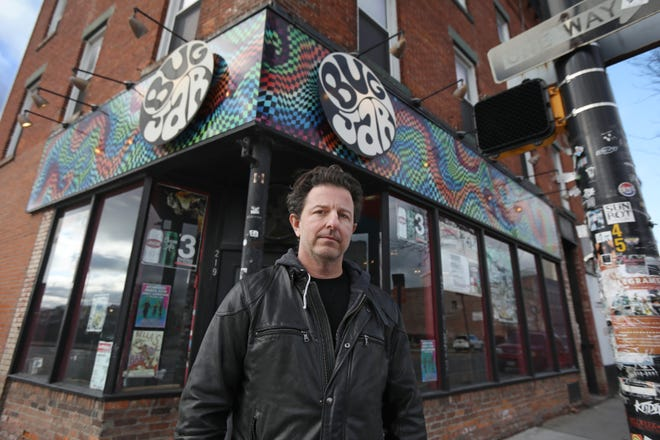 Aaron Gibalski outside his legendary live music venue the Bug Jar on Monroe Avenue in Rochester Monday, Dec. 7, 2020. The club has been closed since the start of the coronavirus pandemic.