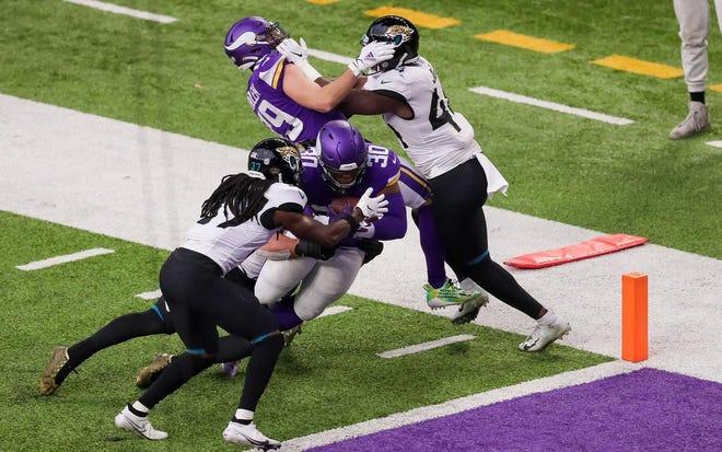 Vikings fullback C.J. Ham scored a 12-yard touchdown in Minnesota's overtime win over Jacksonville on Sunday