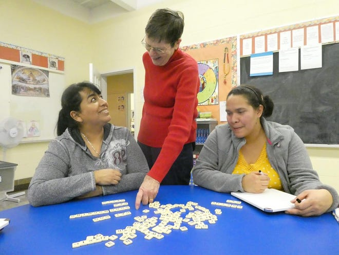 From left to right: Juany Coronado, Sylvia Woodworth and Delcia Berio during a tutoring session for LEARN.
